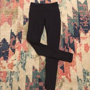 Insulated leggings. Very deep purple or navy colo